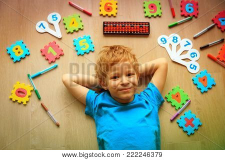 cute little boy learning numbers, mental arithmetic, abacus calculation