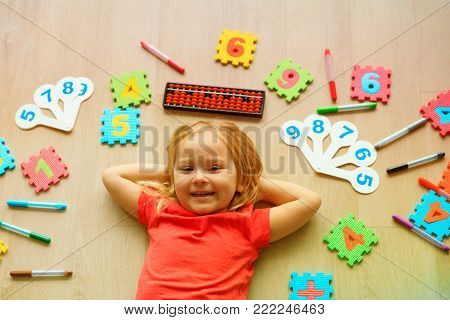 cute little girl learning numbers, mental arithmetic, abacus calculation