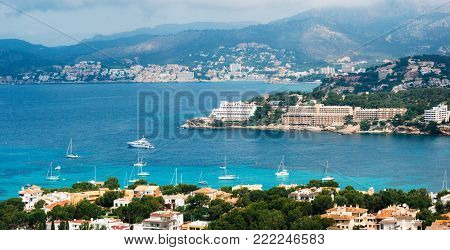 Beautiful panoramic view from above of Santa Ponsa resort, the beach with white sand, sunbeds, hotels and yachts, Mallorca