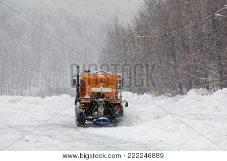 Snow-removing Machine Cleans The Street