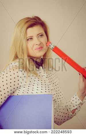 Woman holding binder with many documents and pen. Office, bookkeeping objects concept.