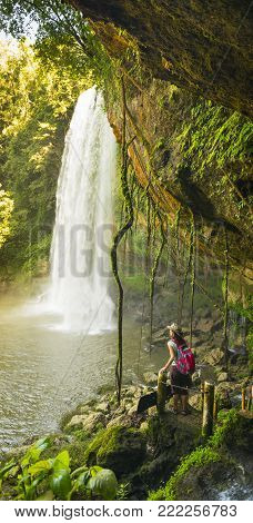 CHIAPAS, MEXICO - NOVEMBER 30: Unidentified tourist on walking path looking at Misol Ha Waterfall on November 30, 2016 near Palenque in Chiapas, Mexico.