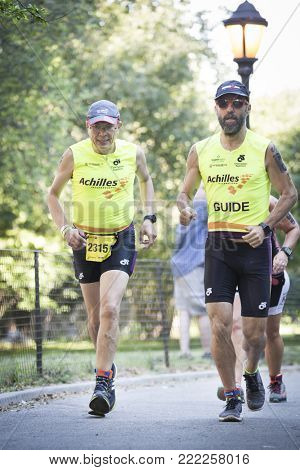 NEW YORK - JULY 16 2017: Achilles International athletes run through Riverside Park in the 10k portion of the Panasonic New York City Triathlon Race, the only International Distance triathlon in NYC.