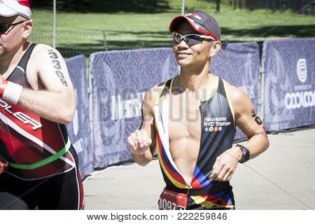 NEW YORK - JULY 16 2017: Athlete approaches the finish line in Central Park of the Panasonic New York City Triathlon Race, the only International Distance triathlon in NYC.