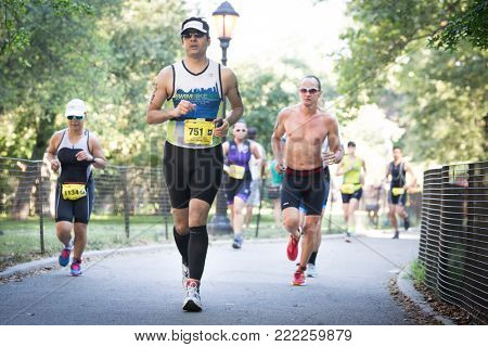 NEW YORK - JUL 16 2017: Athletes run through Riverside Park during the NYC Triathlon Race in Central Park. The run is 10k and the race is the only International Distance triathlon in NYC.