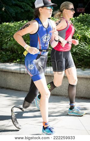 NEW YORK - JUL 16 2017: CAF athlete runs through Riverside Park during the NYC Triathlon Race in Central Park. The run is 10k and the race is the only International Distance triathlon in NYC.