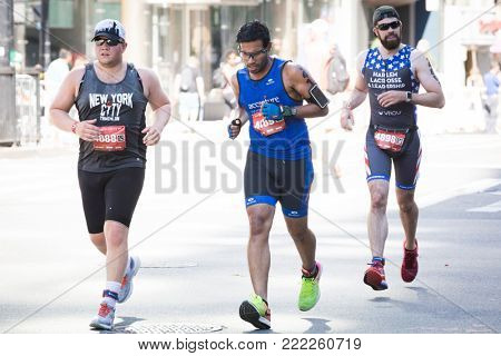 NEW YORK - JUL 16 2017: Athletes run on West 72nd St during the 10k portion of the Panasonic New York City Triathlon Race, the only International Distance triathlon in NYC.