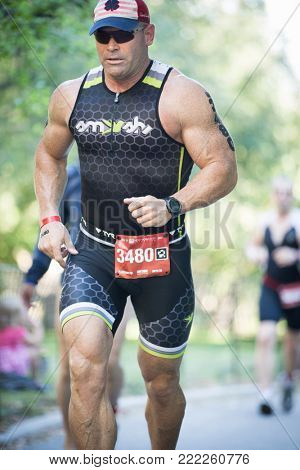 NEW YORK - JUL 16 2017: Athlete runs through Riverside Park during the NYC Triathlon Race in Central Park. The run is 10k and the race is the only International Distance triathlon in NYC.
