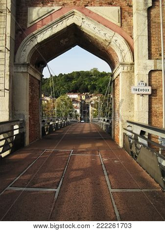 Huge,old bridge gate made from red bricks,lead in the city Trevoux
