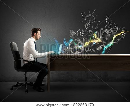 Businessman in a desks works on a creative project on a desk