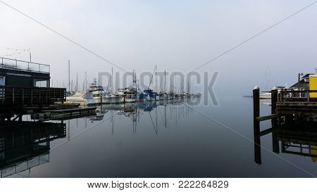 Boating harbor on a cold, misty morning