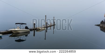 Boating dock on a misty, cold morning