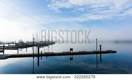 Early morning image of a misty morning and boat dock