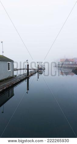 Pleasure craft pier and docks on glassy still water