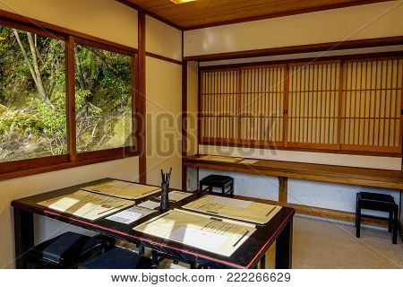 Kyoto, Japan - Dec 26, 2015. Interior of a traditional Japanese house with rice paper doors in Kyoto, Japan.