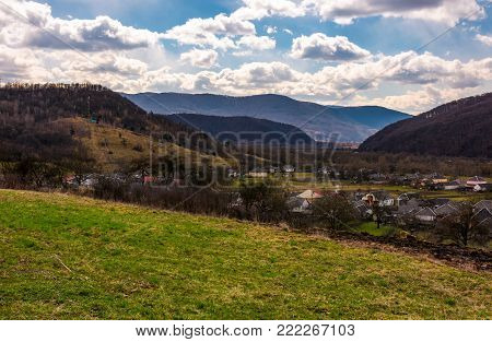 village in mountainous rural are. beautiful countryside landscape in springtime. Cloudy afternoon in Carpathians