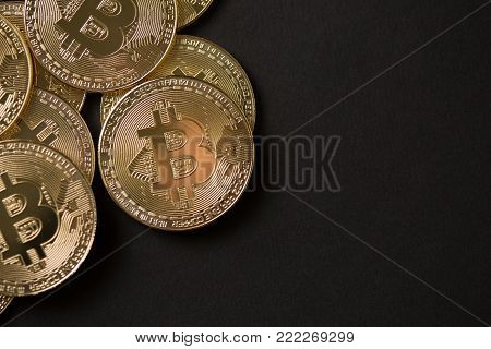 Bitcoin gold coin on dark background. Virtual cryptocurrency concept.