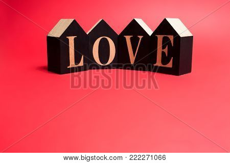 Love text on cubes on a red background
