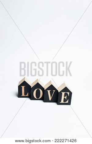 Love text on black cubes on a white background