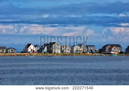 Beautiful houses along the water of Havre aubert  in magdalen island in Quebec, Canada