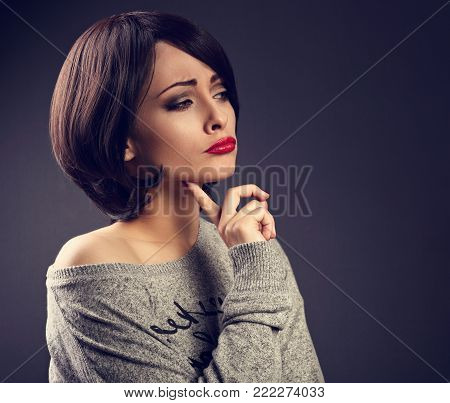 Skeptical Unhappy Grimacing Thinking Young Woman With Short Black Hair Style Looking Up On Empty Cop