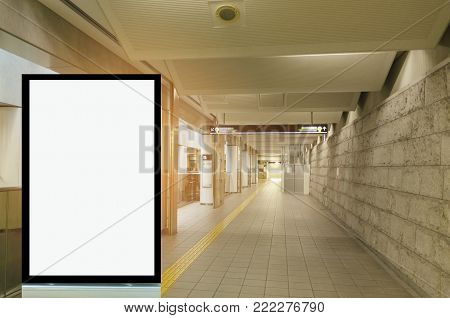 vertical blank advertising billboard or light box showcase on wall at airport or subway train station, copy space for your text message or media content, advertisement, commercial, marketing concept