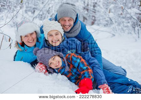 Happy Family having fun winter Outdoors. Snow. Winter Vacation