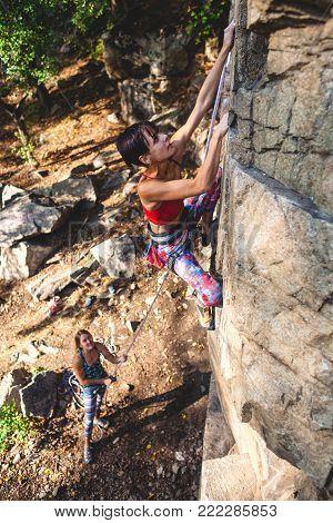 Girl Climber On A Rock.