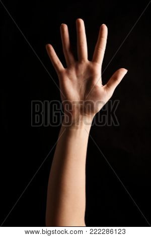 Female hand showing open palm, number five isolated at black background. Counting, gesturing, enumeration concept, cutout, copy space