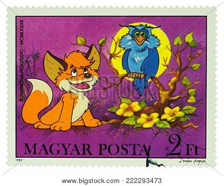 Moscow, Russia - January 16, 2018: A stamp printed in Hungary shows Owl and little fox, series