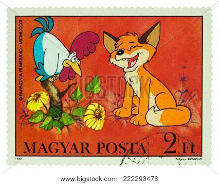 Moscow, Russia - January 16, 2018: A stamp printed in Hungary shows rooster and little fox, series