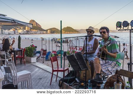 Rio de Janeiro, Brazil - Dec 17, 2017: Band playing bossa nova and samba at a kiosk on Copacabana Beach, Rio de Janeiro, Brazil