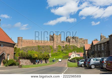 BAMBURGH CASTLE, NORTHUMBERLAND, ENGLAND, UK-JUNE 12TH 2017: Beautiful summer sunshine and blue skies were enjoyed by visitors to Bamburgh Castle, Northumberland, on Monday 12th June 2017