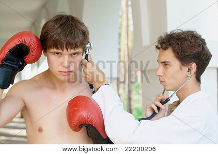 Doctor checking boxers brains