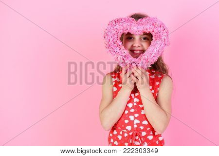 Child Look Through Rosy Heart On Pink Background