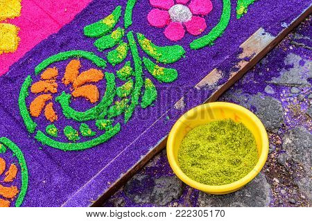 Antigua, Guatemala -  April 13, 2017: Detail of dyed sawdust Holy Thursday procession carpet in town with most famous Holy Week celebrations in Latin America