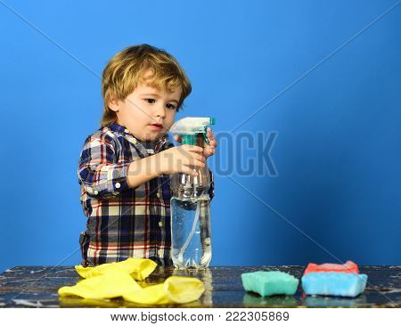 Child In Checkered Shirt On Green Background.