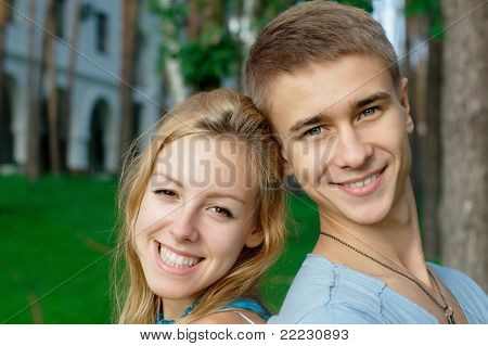Young smiling couple at the park