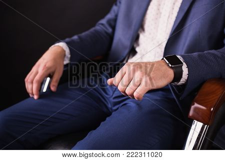Hands close-up. Director of the firm. Man's hands. Stylish new watches on hand. Keep your hands in your fist. Conceptual picture with hands. A successful young businessman in a business suit