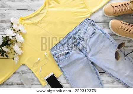 Womens fashion white clothing, shoes, accessories (white leather sneakers, sweatshirt, headphones, perfume. Fashion concept. View from above, Flat lay. Spring summer collection