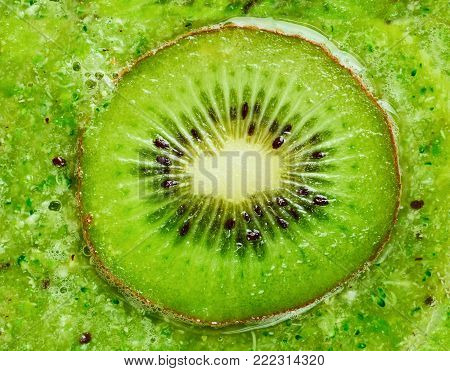 Kiwi smoothies and kiwi fruit background, top view. Bright and juicy