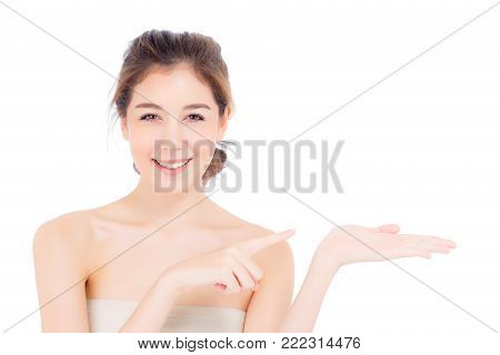 Asian Beautiful Young Woman Showing With Healthy Clean Skin Presenting Something Empty Copy Space On