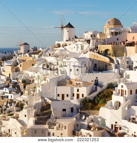 World famous Oia village or Ia at sunset, Santorini island, Greece.