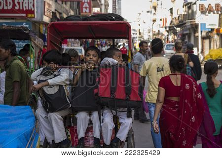DELHI, INDIA - October 10 2014 : school boy in rickshaw for go to school in Morning at main bazar in Paharganj.