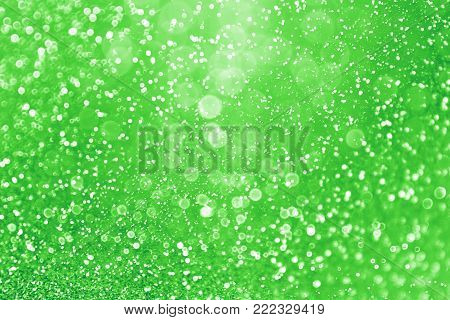 Fancy abstract green glitter sparkle confetti background for happy birthday party invite, St Patrick's Day luck, lucky Saint Paddys Irish texture, Spring sale, Christmas fun or celebrate wedding bash