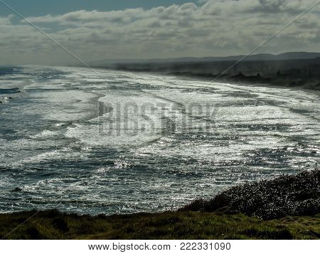 Waves rolling into the beach, Muriwai Beach, Auckland, New Zealand