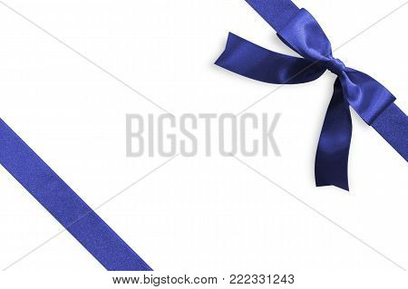 Blue bow satin navy blue ribbon band stripe fabric on corner (isolated on white background with clipping path) for Christmas holiday gift box present wrap design decoration ornament element