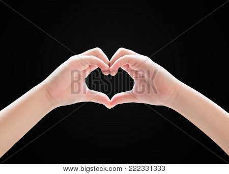Heart-shape hand gesture of kid's body language for children's love, peace, kindness and world humanitarian aid concept. (isolated on black background with clipping path)
