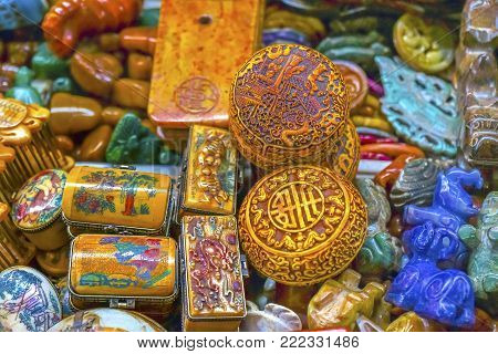 Old Colorful Chinese Ceramic Trinkets Souvenirs Snuff Boxes Panjuan Flea Market  Beijing China. Panjuan Flea Curio market has many fakes, replicas and copies of older Chinese products, many ancient.