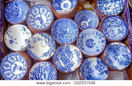 Old Chinese Design Blue White Ceramic Plates  Panjuan Flea Market  Beijing China. Panjuan Flea Curio market has many fakes, replicas and copies of older Chinese products, many ancient.
